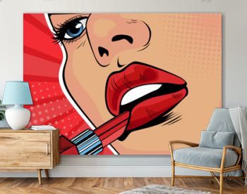Girl paints her lips with red lipstick. The beauty of the face, makeup. Vector illustration in pop art retro comic style