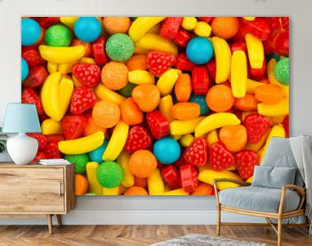 Top view on background texture of colorful hard candies. Copy space for text.