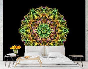 Green, yellow and red abstract flame mandala flower, ornamental round pattern on black background. Yoga theme.